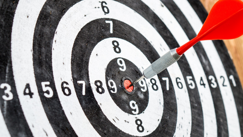 Picture of a dart board with a dart in the bullseye position symbolising having found your financial number..